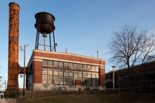 The 1924 factory building along Statesville Avenue, with its rusted steel smokestack and capacious windows, is destined for renovation and reuse. All photos: Nancy Pierce