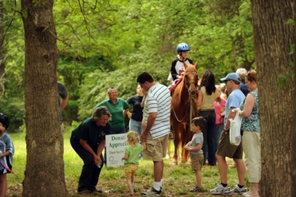 Children and adults gather near the Anne Springs Close Greenway in Fort Mill, S.C., April 2010.