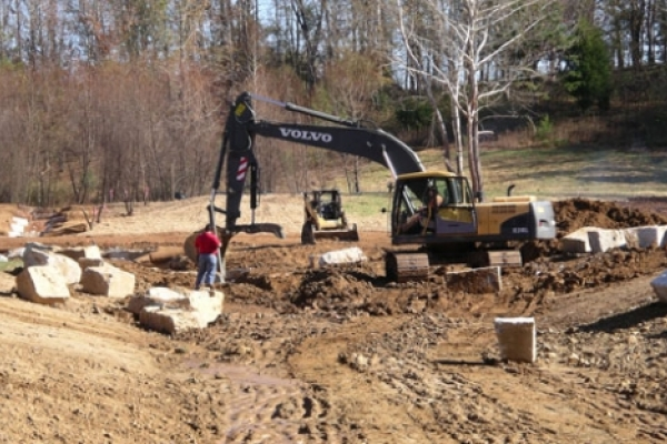 Digging the channel between the dam and Uwharrie River.