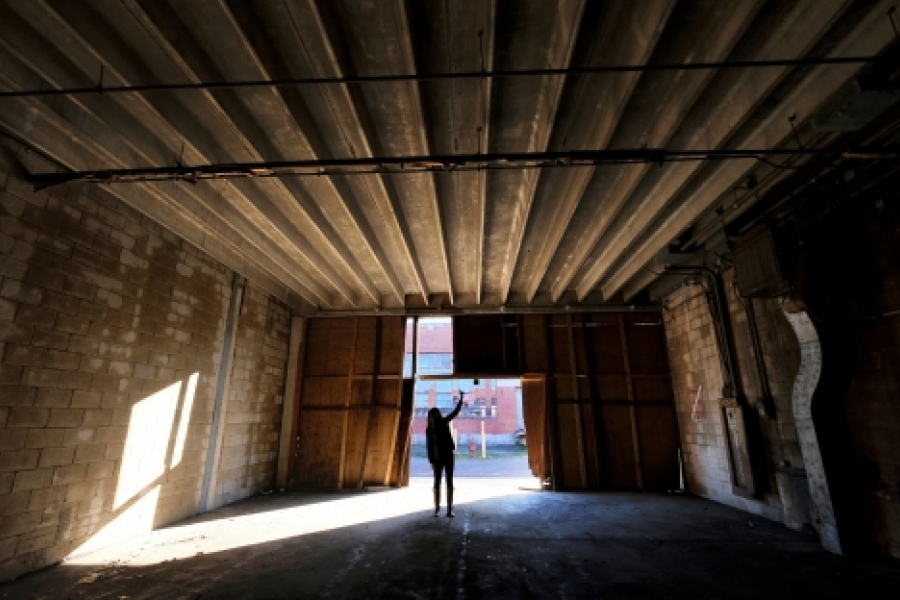 Warehouses once used to store missiles will be rented for small entrepreneurial and creative space, says Varian Shrum, ATCO Properties' community manager at CAMP North End, shown here.