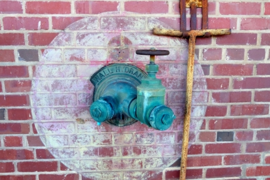 "Old hose connection at CAMP North End. Adaptive reuse projects offer a sense of the past as well as a generally ""greener"" energy footprint than demolition and rebuilding."