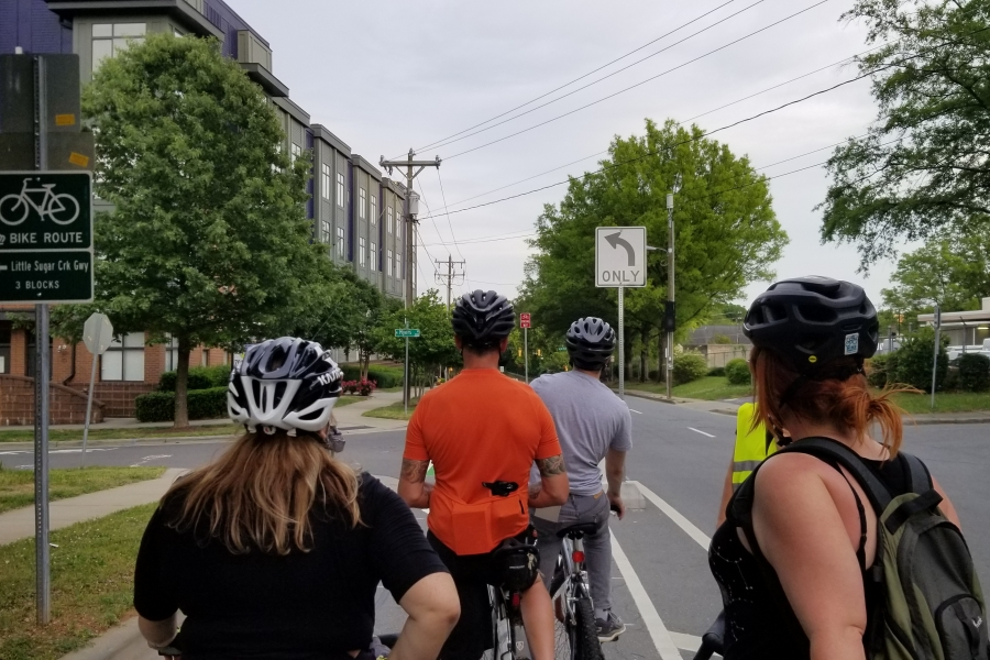 Bicyclists try out Charlotte's first protected bike lane in uptown. Photo: Katie Zager.