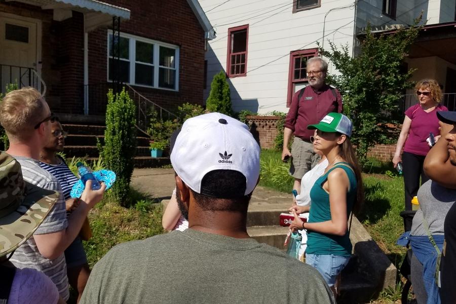 Historian Tom Hanchett leads a walk through the historic McCrorey Heights neighborhood near Johnson C. Smith University.