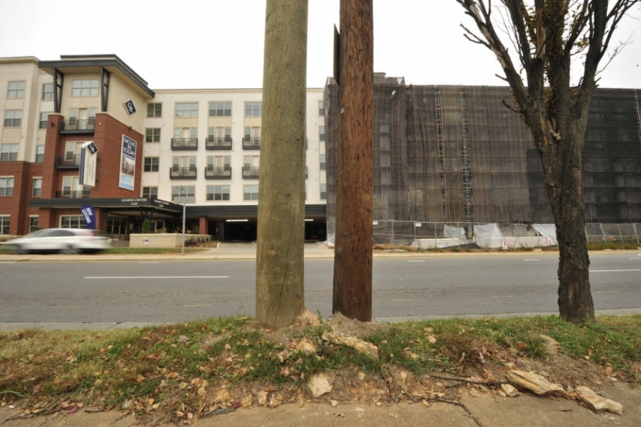 South Boulevard, Charlotte: Upscale apartments replace old businesses along South Boulevard (which used to be U.S. 21) as it parallels Charlotte's Lynx Blue Line light rail. Under construction here is Colonial Homes at South End.