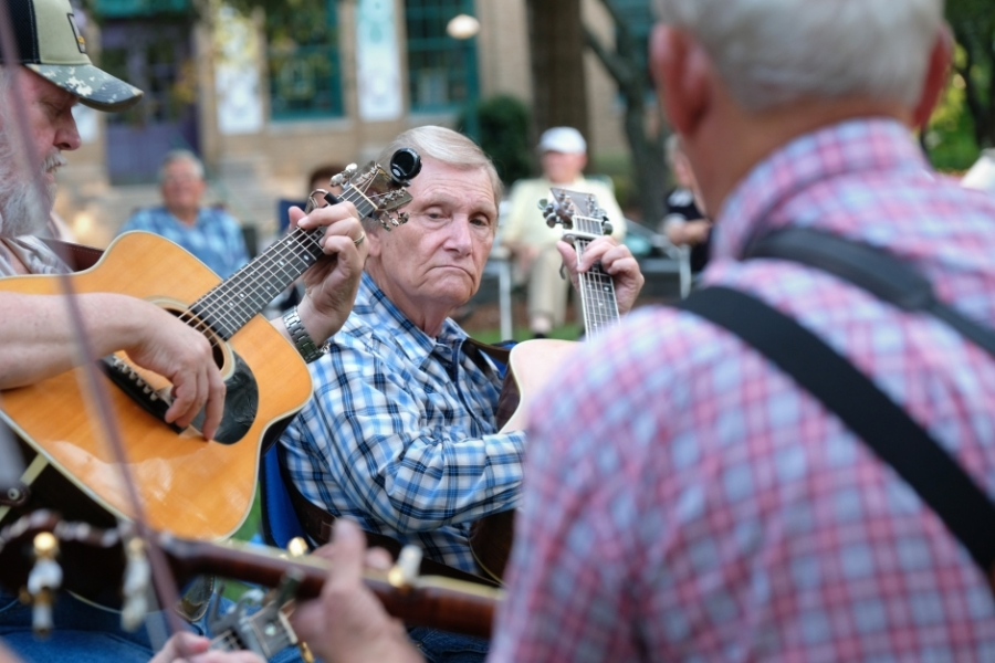 Musicians at the Bluegrass & Old-Time Jam Session on the square in Shelby, playing in front of the Earl Scruggs Center. Photo: Nancy Pierce.