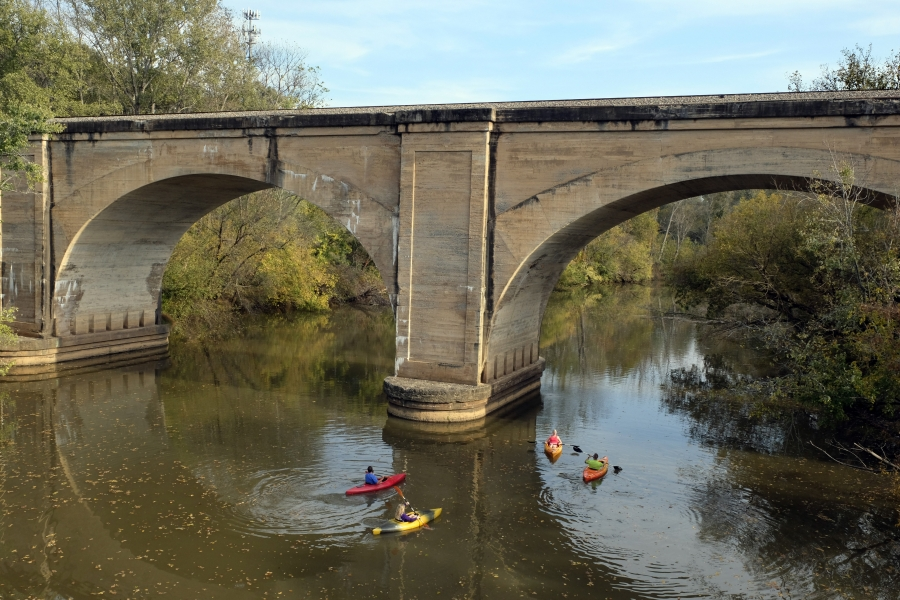 Paddlers on the South Fork at the Norfolk Southern Railroad trestle in Cramerton. Photo: Nancy Pierce.