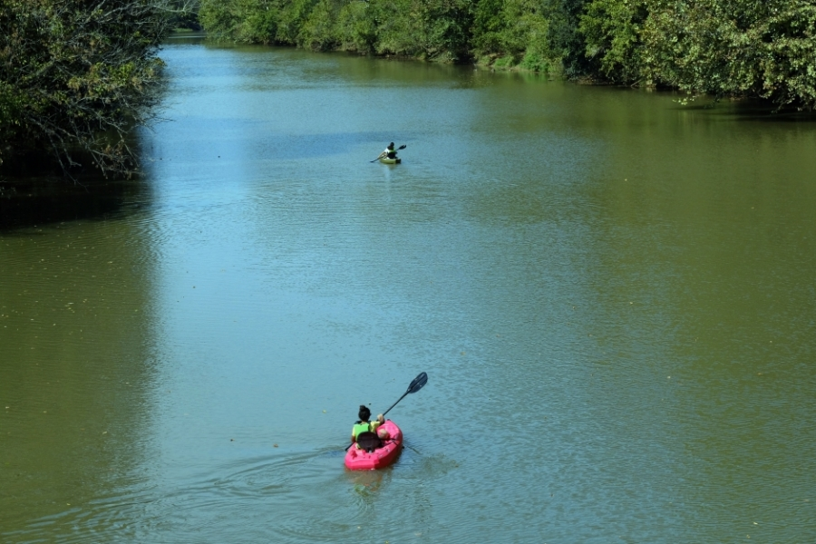 Kayakers paddling on the South Fork as seen from the Goat Island bridge. The South Fork was once so polluted it was called the Rainbow River. Photo: Nancy Pierce