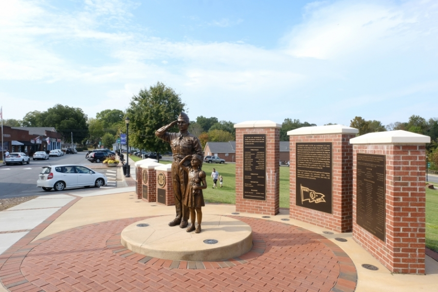 """A Cramerton war memorial that also pays tribute to the town's heritage as a center of """"Army khaki"""" production for uniforms. Photo: Nancy Pierce."""