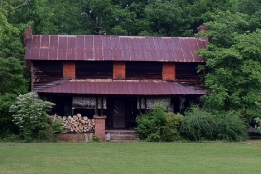 Ivy growing on native stone chimney of Vanhoy House in Uwharrie community; typical I-house style.
