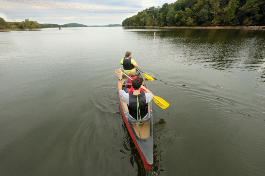 The 10 Days of Uwharrie outdoor festival in October 2019 included canoe rides on Badin Lake. Overhead power lines are from Badin's hydroelectric dam. Photo: Nancy Pierce.