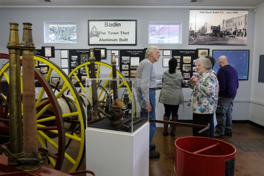 "Visitors toured the Badin Historic Firehouse Museum during the 10 Days of Uwharrie outdoor festival on October 19. Note the ""Town that Aluminum Built"" placard. Photo: Nancy Pierce."