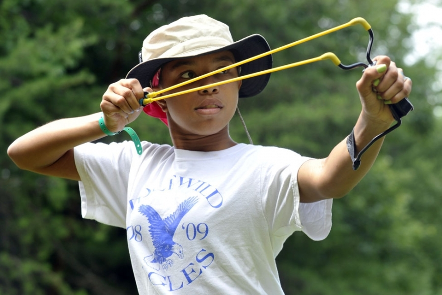 A Charlotte girl takes aim, at the Girl Scouts' Camp Ginger Cascades.