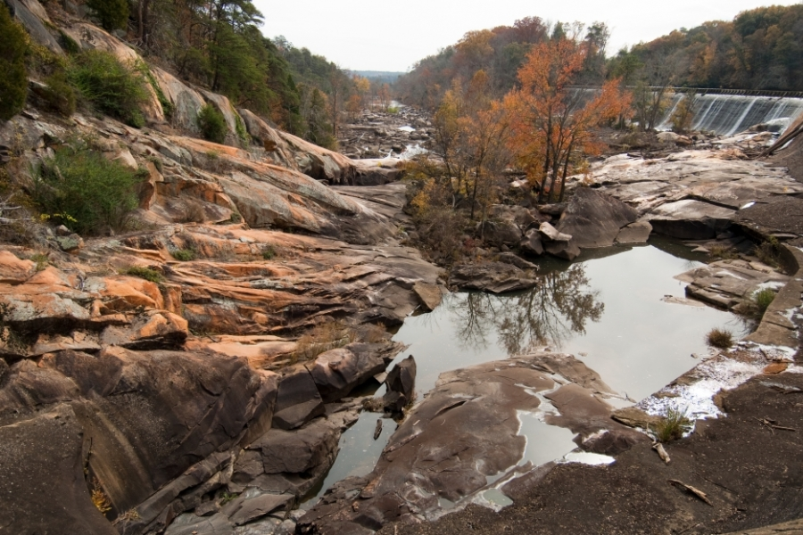 The dry channel at Great Falls, S.C. The falls once crashed over these rocks, before they were diverted for hydroelectric power. This is where Duke Energy plans to release more water into the channel to fuel whitewater adventures. Photo: Nancy Pierce