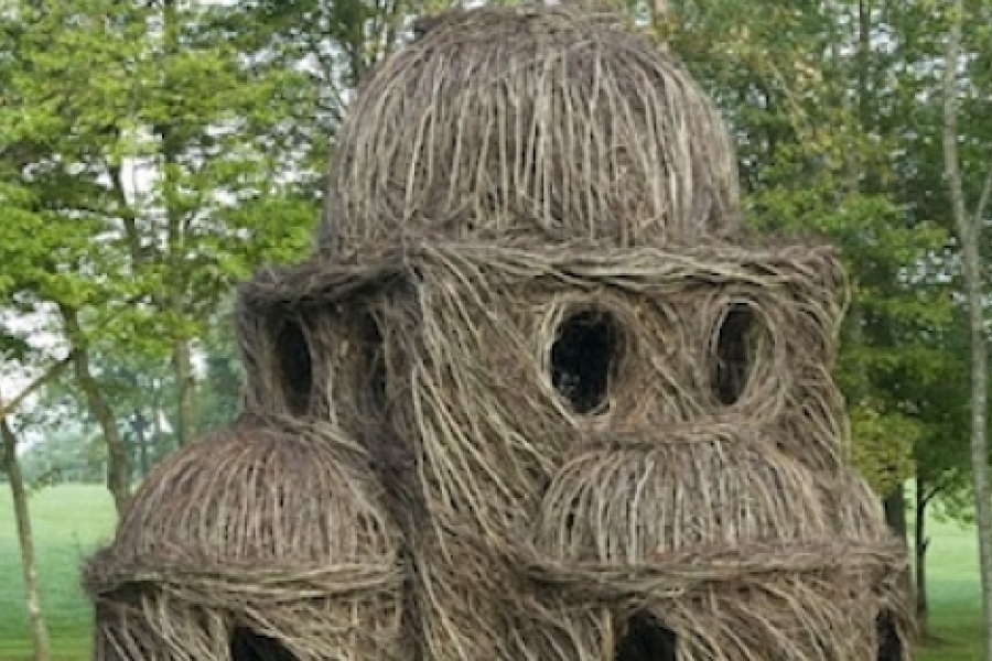 """""""Hocus Pocus,"""" a 'natural architecture' sculpture by Patrick Dougherty, was erected on Bittersweet Farm in Ennice, N.C. (2008). Photo: Robin Dreyer"""