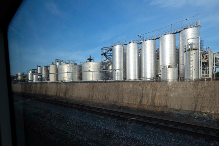 Ever wondered what's in these tanks visible from the Blue Line and from South Boulevard, between the Tyvola and Woodlawn stations? It's Cargill's tropical oils refinery, which runs 24/7 and produces more than 400 million pounds of edible oils annually. Photo: Nancy Pierce