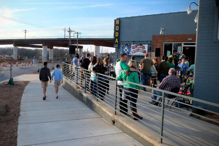 On the newly opened Blue Line Extension at North Davidson Street and Craighead Road, NoDa Street Market opened in summer 2017, offering a coffee house, pub, restaurants and a brewery. Situated between the 36th Street and Sugar Creek Road stations, this area shows how NoDa's entertainment district is expanding northward into old industrial buildings. Photo: Nancy Pierce
