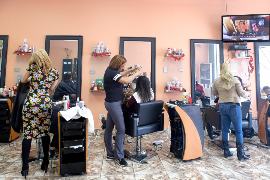 All the stalls were booked on a weekday afternoon at Mery Mi Salon at the North Pointe Plaza near the Old Concord Road Station: The shop's front window prominently advertises a Dominican stylist. Photo: Nancy Pierce