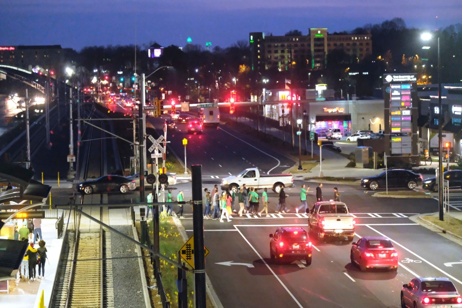 The day after the Blue Line Extension opened to the public was St. Patrick's Day, and a steady stream of revelers rode the short distance – one stop – from the UNC Charlotte campus station to the Shoppes at University Place, which offers an array of bars and restaurants. Photo: Nancy Pierce