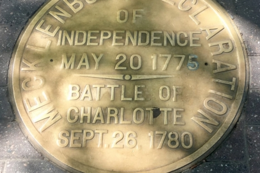 Participants in the May 20 City Walk led by Scott Syfert saw this plaque in the sidewalk at Trade and Tryon streets. It commemorates the story, never fully verified, of a May 20, 1775, declaration of independence in the small hamlet named Charlotte. The declaration is known as the Meck Dec. Photo: Mary Newsom