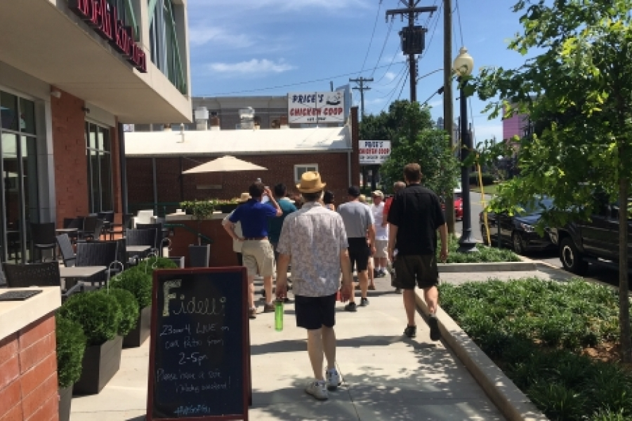 City Walk participants see new construction and the newly opened Fidelli Kitchen,  left, cheek-by-jowl with the venerable Price's Chicken Coop on Camden Road. Photo: Mary Newsom