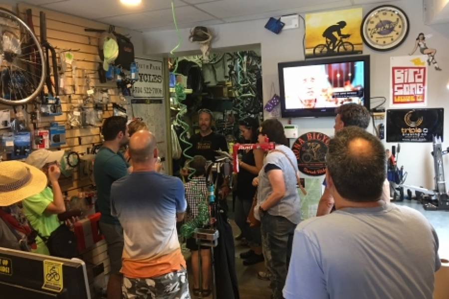 City Walk participants hear from Bart Stetler at Queen City Bicycles on Park Avenue, one of South End's small, locally owned shops. Photo: Mary Newsom