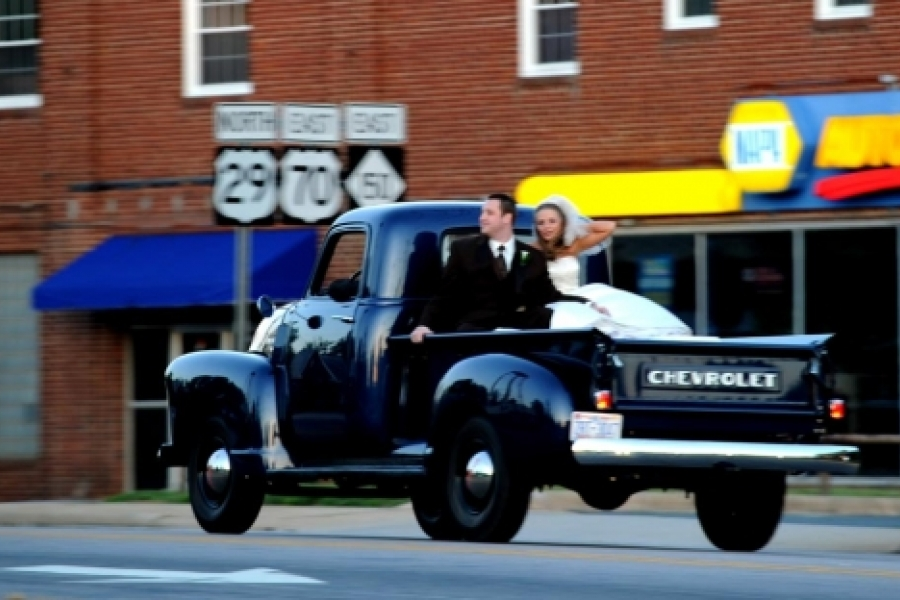 Newlyweds in back of pickup truck on a spring Saturday in Salisbury.