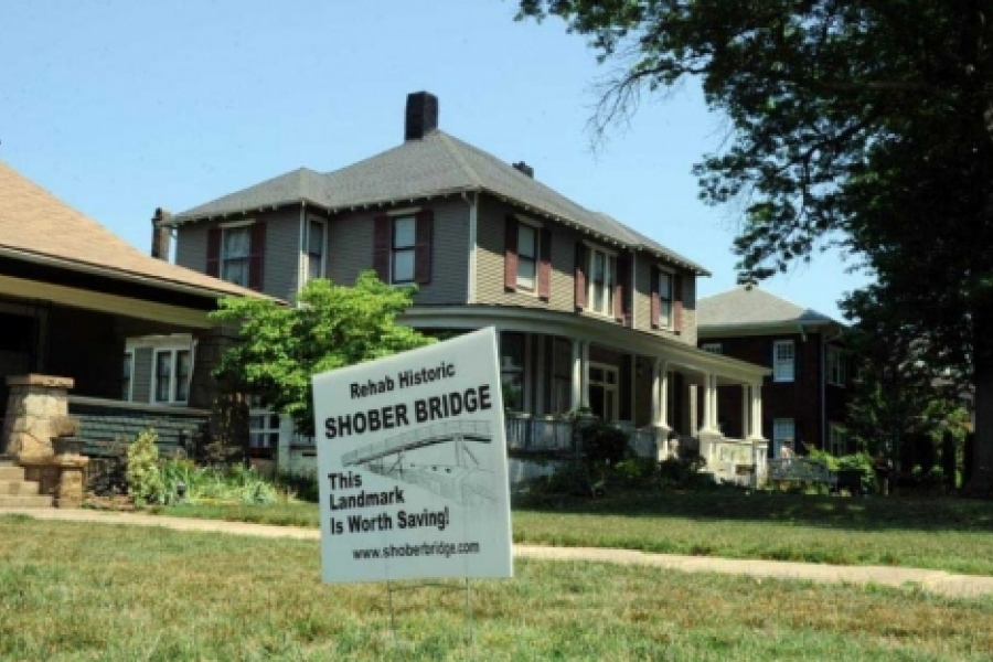 A sign in support of preserving Shober Bridge on the front lawn on Fulton St. in the Historic District.