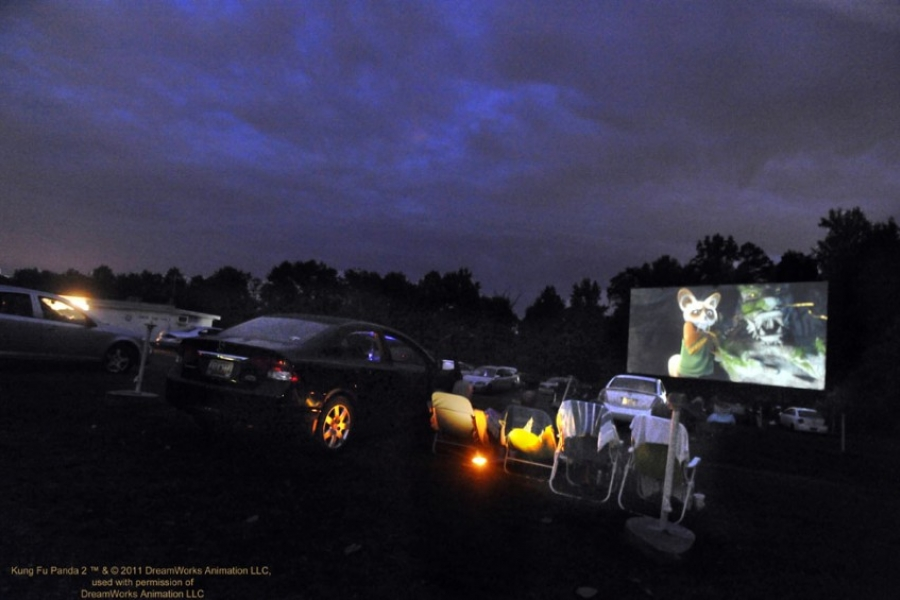 Shelby's Sunset Drive-In theater on a hot summer night.