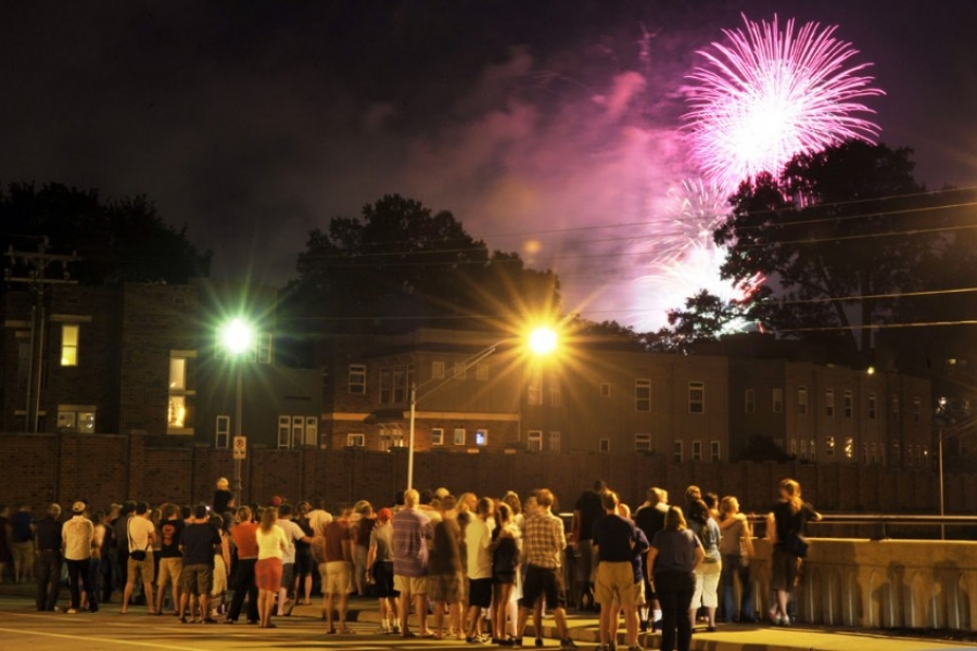 Crowd in Charlotte watches Fourth of July fireworks from the Hawthorne bridge.
