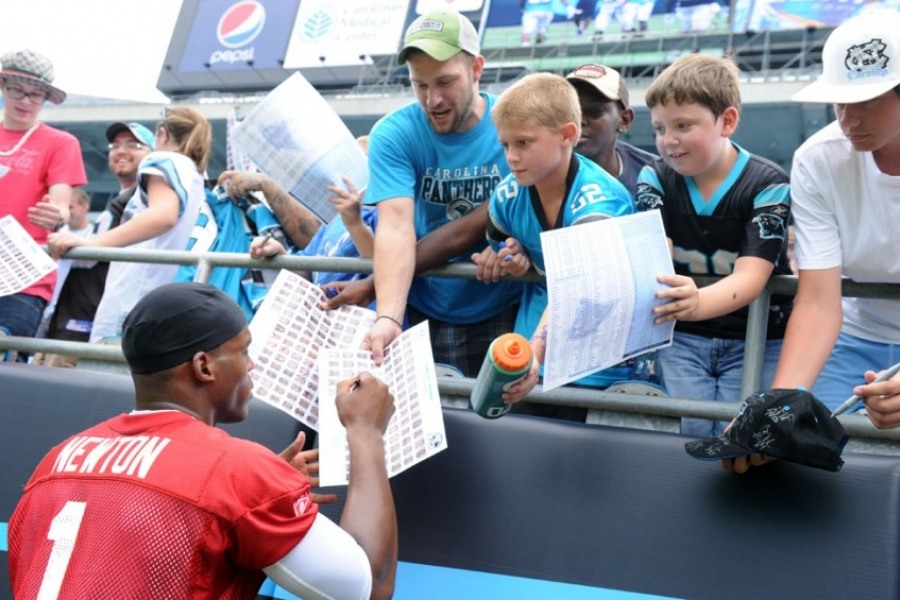Already a fan favorite, Cam Newton signs autographs at Panthers Fan Fest on Aug.6.