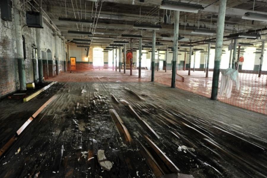 Water damage to floor beams will be repaired before this floor is sandblasted. Photo: Nancy Pierce