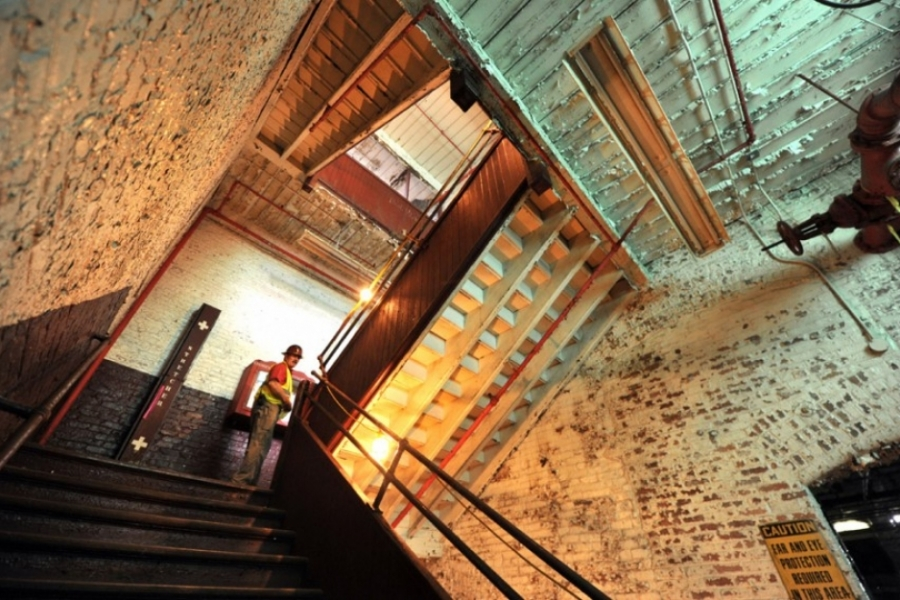 A staircase between residential floors in the Loray Mill. Photo: Nancy Pierce