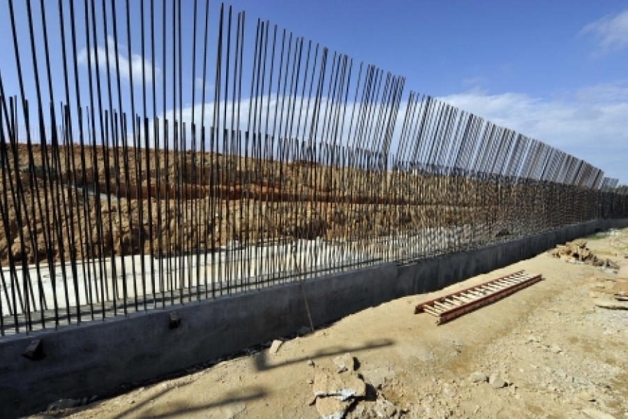 """On Cullman Avenue, between Little Sugar Creek and light rail, rebar set in place for a retaining wall. Photo: Nancy Pierce 6-11-15  Rebar has been set in place for a cast-in-place retaining wall, which will be part of the art wall, """"Trap plant, sundew and leaves,"""" from artist Carolyn Braaksma. This scene is along Cullman Avenue in NoDa, between Little Sugar Creek and the rail line. Photo: Nancy Pierce"""