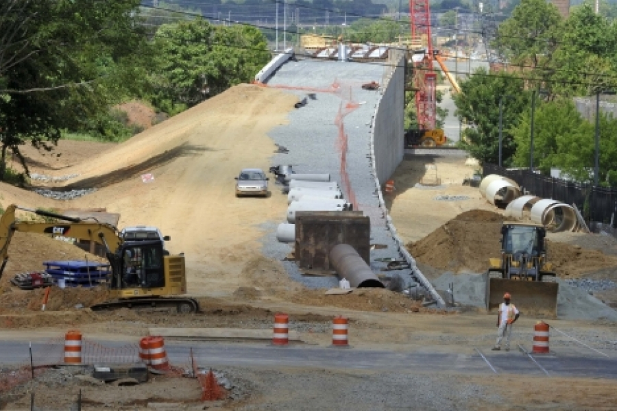 A retaining wall rises up to the bridge over the CSX freight rail tracks. View is looking east from 12th Street, June 11, 2015. Photo: Nancy Pierce
