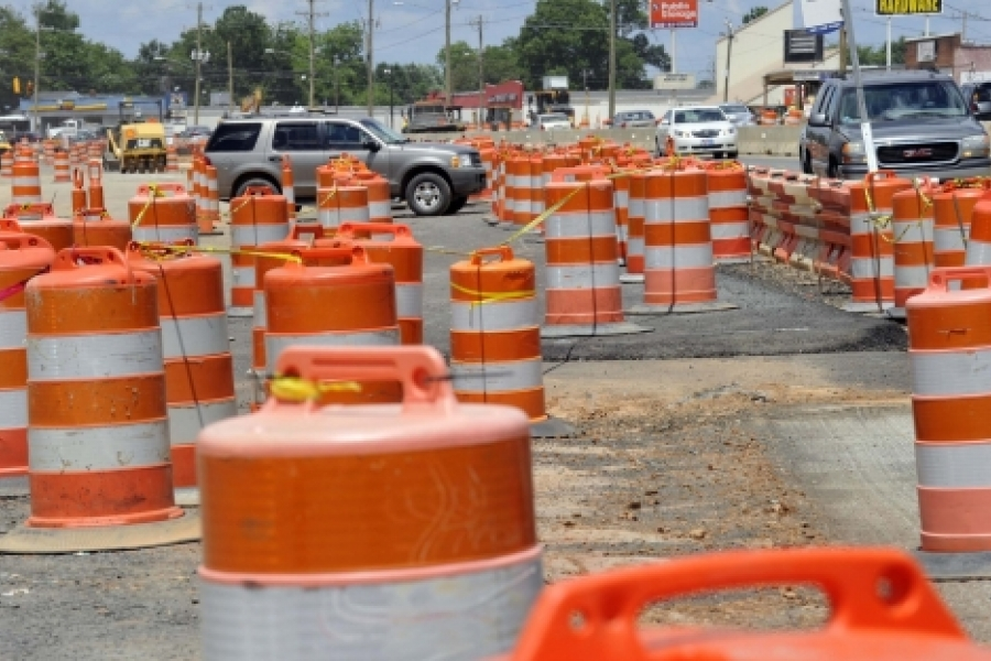 For months, construction barrels have decorated North Tryon Street, where the Blue Line Extension will run in the median. These are near Orr Road. Photo: Nancy Pierce