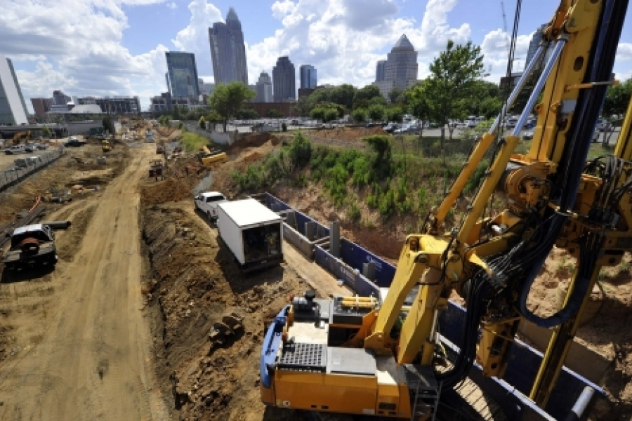 A view of the Charlotte skyline from the construction site at East 11th Street. The rig is drilling a hole to set piles for panel wall construction. Photo: Nancy Pierce