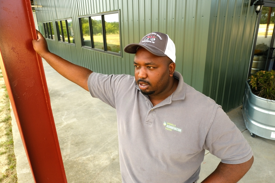 Davon Goodwin, manager of Sandhills AGInnovation Center in Ellerbee, NC, looks out over the fields. Photo: Nancy Pierce