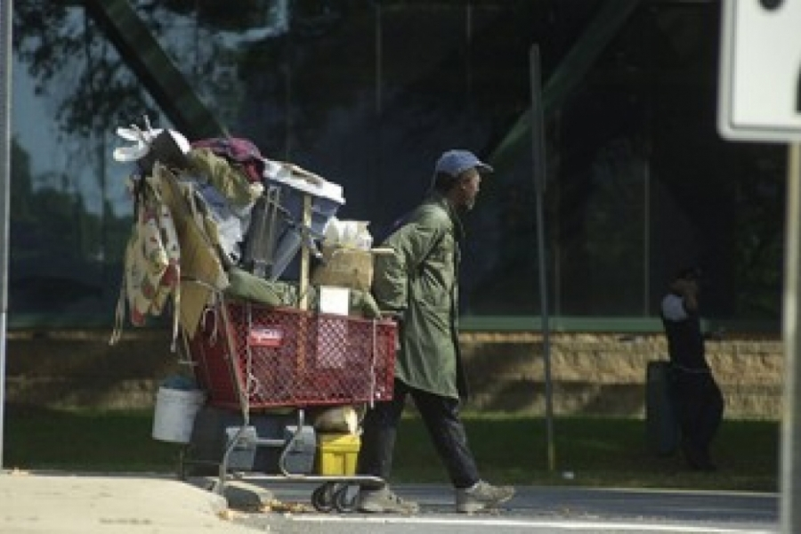 Homeless man with shopping cart of possessions, Charlotte.