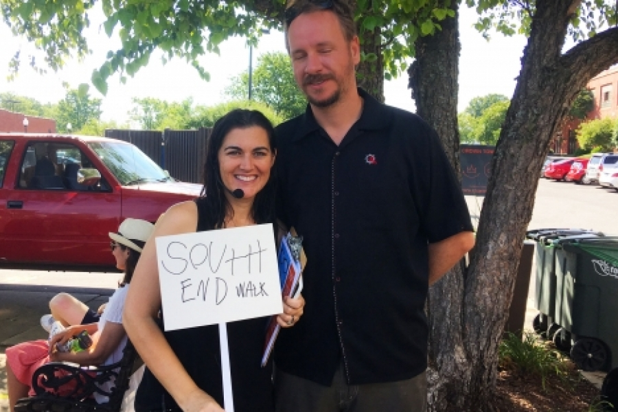 Sonjia Parker, with partner, Max, led the May 27 City Walk through parts of South End. Photo: Mary Newsom