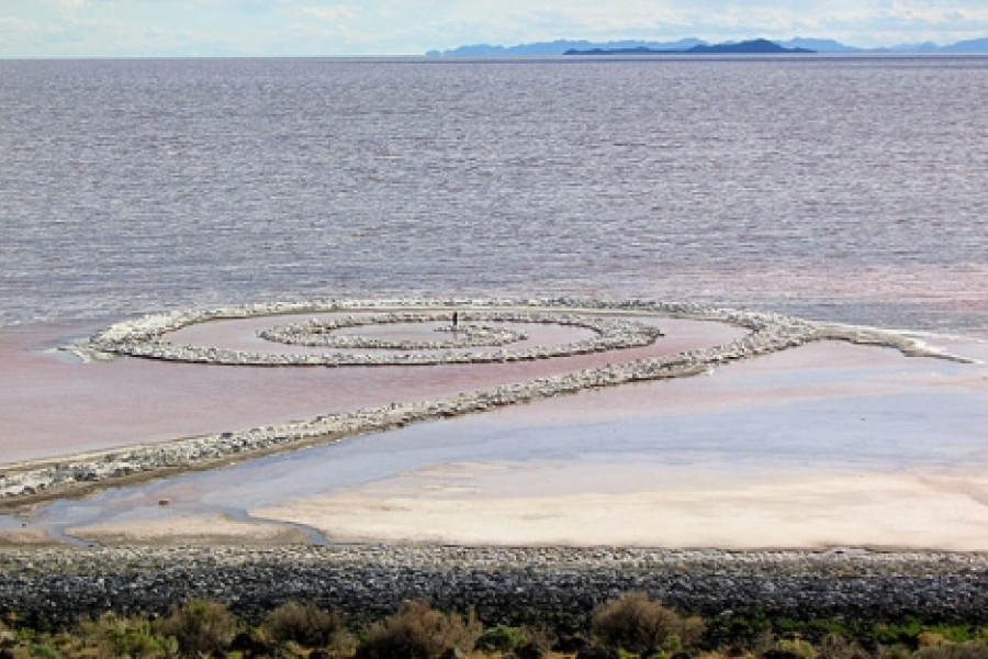 """A person standing in the middle of Robert Smithson's """"Spiral Jetty"""" on the Great Salt Lake in rural Utah. Photo: Soren Harward"""