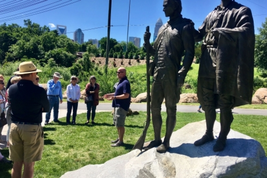 Statues near Seventh Street depict Thomas Spratt, left, and his friend, the Catawba Indian Chief known as King Haigler. Scott Syfert led a May 7 City Walk describing the statues and the people depicted, part of the Trail of History on one section of the Little Sugar Creek Greenway. Photo: Mary Newsom