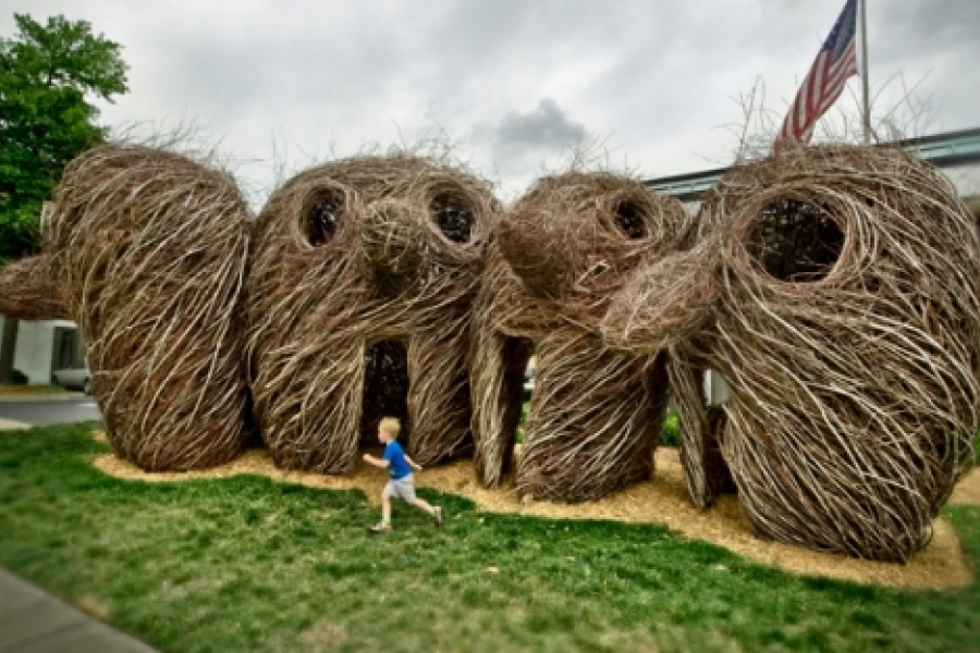 """Patrick Dougherty's 2010 sculpture, """"Ain't Misbehavin',"""" is made from maple saplings. It was constructed in front of the Performing Arts Center of Winthrop University, in downtown Rock Hill, S.C. Ain't Misbehavin' consists of five oversized heads woven with a theatrical stare. Photo: Zan Maddox"""