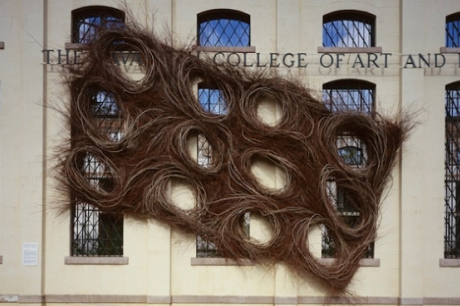 """Patrick Dougherty's """"Cell Division,"""" a 32 foot high sculpture made from willow saplings installed on the face of the Savannah College of Art and Design, 1998. Photo: Wayne Moore"""