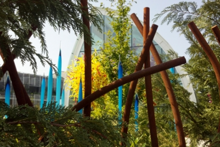 Chihuly Garden and Glass exhibition at the foot of the Space Needle in Seattle, Washington. The picture shows some of Chihuly's huge blown glass artworks in a garden setting as nature and art intermingle. Photo: Melissa Currie