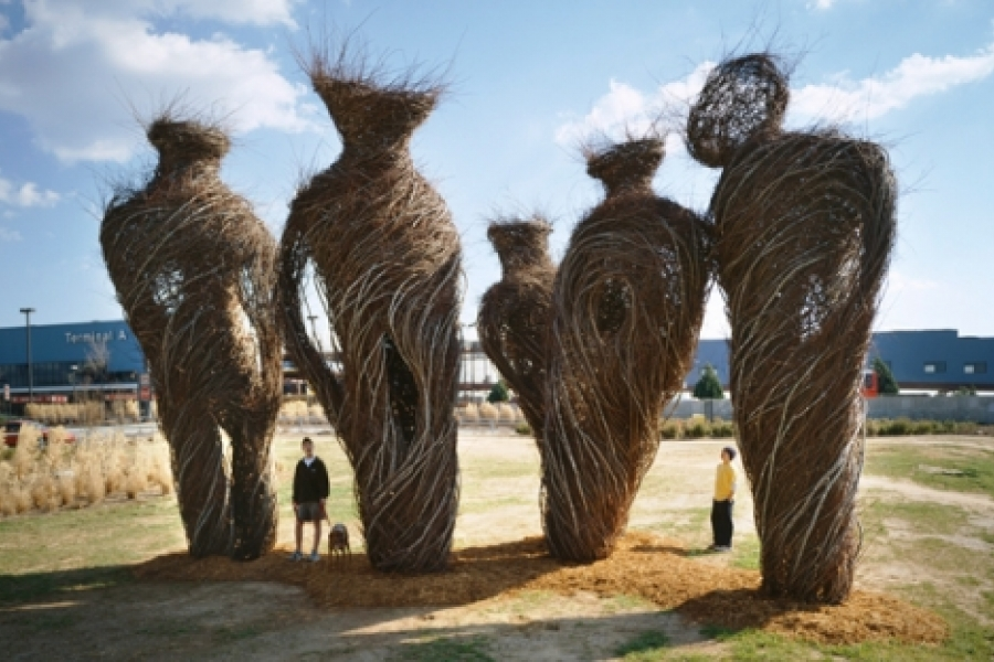 """Patrick Dougherty's """"Stand By"""" (2000) maple and elm sculptures were located at the entrance ramp to the Raleigh-Durham Airport's main parking deck, taking advantage of the driver's need to stop to take a ticket to park. Photo: Jerry Blow"""