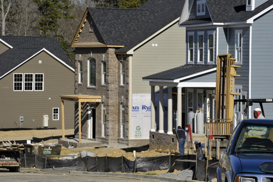 The north Mecklenburg town of Huntersville, population 900 in 1950, has soared in recent decades to almost 55,000 people. This 2013 photo shows construction in Vermillion, a Huntersville subdivision. Photo: Nancy Pierce