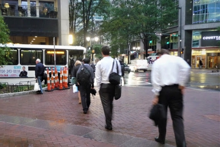 Rush hour CATS express bus boarding at Third and South Tryon streets in uptown Charlotte. Photo: Martin Zimmerman