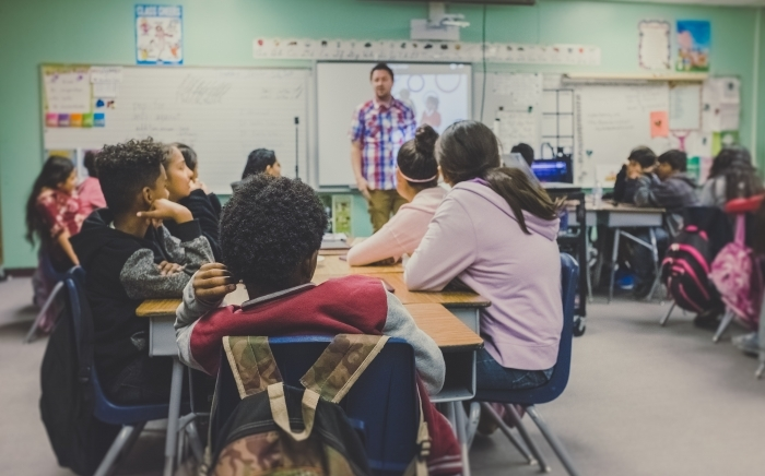 Students in a classroom. Unsplash.