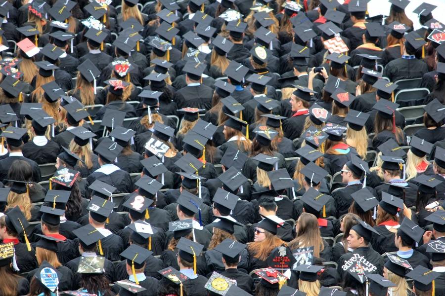 College graduates wearing hats