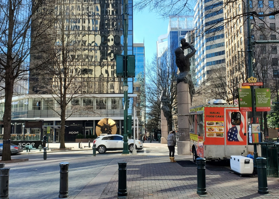 A lone customer waits for food in Charlotte at a food truck